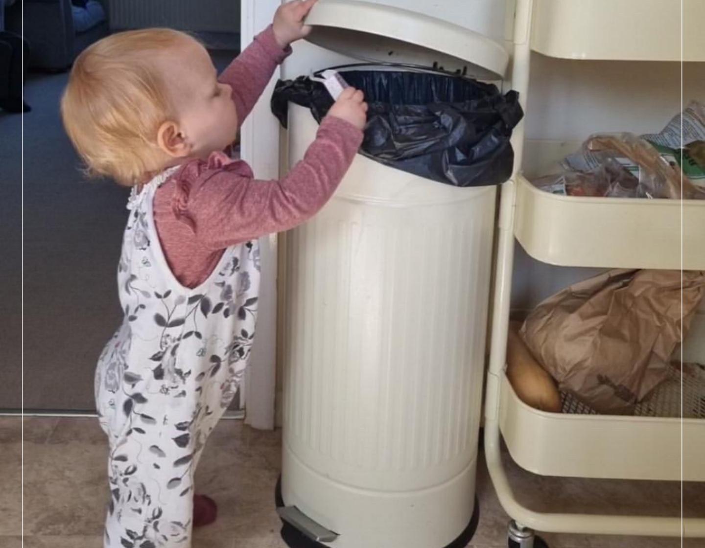 Child using bin FB block