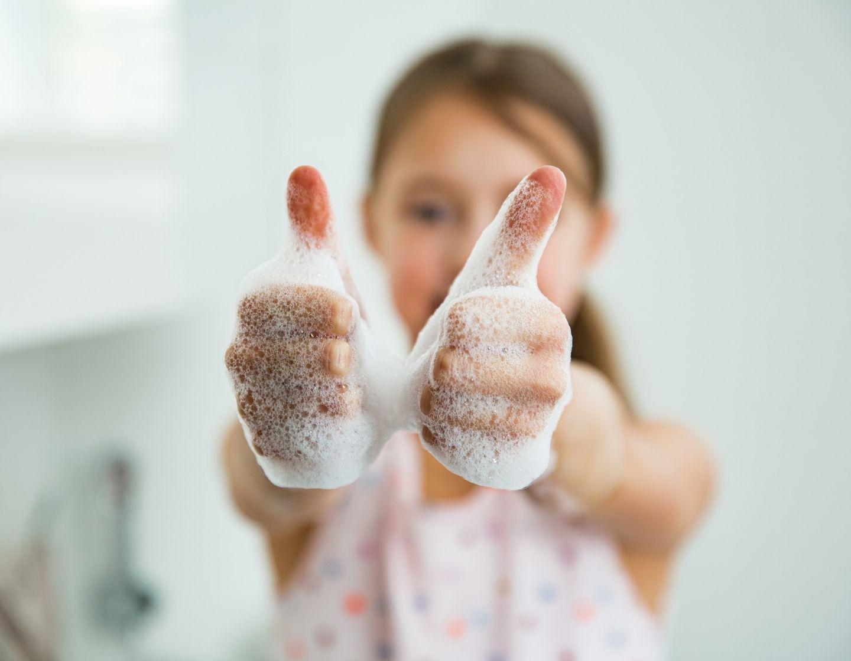 school girl washing hands web