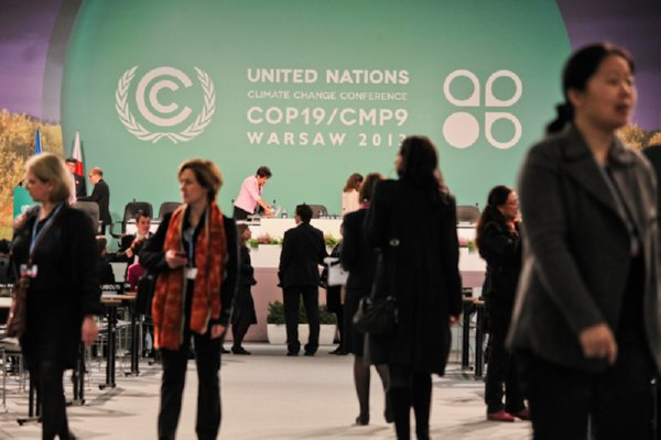 Image of delegates at COP 19 Warsaw climate convention 2013-SaveMoneyCutCarbon