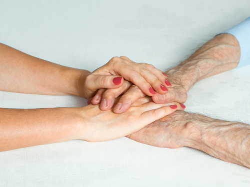 Care homes energy savings - image of elderly and carer hands together - SaveMoneyCutCarbon
