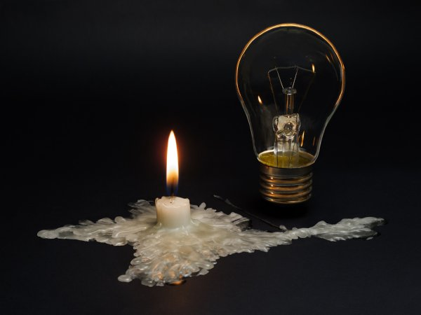 Power shortages - candle and lightbulb